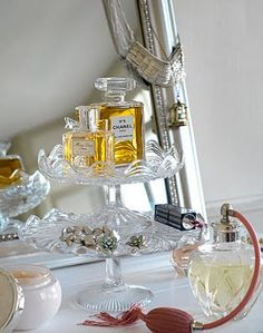Love the idea of using a cake stand type item as storage on a dressing table.