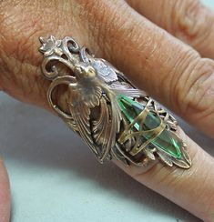 Gothic Ring Steampunk Couture Bird Ring Nature Inspired Green. $37.99, via Etsy.