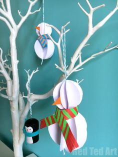 Oh so gorgeous and surprisingly EASY Paper Snowman Ornament DIY for you to try today. Perfect Christmas Ornaments or Winter Decor idea! And all you need is paper. We love easy paper crafts!