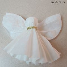 Directions for making an easy and inexpensive DIY Christmas tree angel ornament out of paper coffee filters.