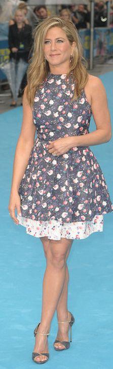 Jennifer Aniston: Dress – Christian Dior  Jewelry – Fred Leighton  Purse – Burberry  Shoes – Giuseppe Zanotti