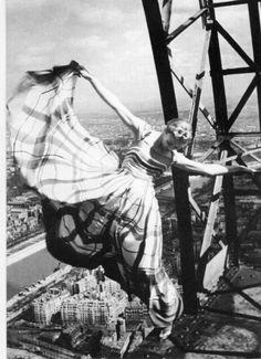 Erwin Blumenfeld, a Vogue photographer, took this gravity-defying shot of his model hanging from the Eiffel Tower.