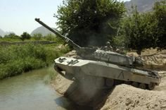 Leopard 1 crossing a water way after completing a sweep patrol, Afghanistan, June 2007 Military Armor, Military Guns, Military Vehicles, Offroad, Patton Tank, World Tanks, Tank Armor, Canadian Army, Photo Images