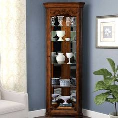 This Tall Lighted Corner Curio Cabinet will enhance any space you place it in. This Tall Lighted Corner Curio Cabinet has 1 Glass Door. Curio Cabinet Decor, Crockery Cabinet, Corner Curio, Corner Shelves, Corner Desk, Glass Shelves, Display Shelves, Corner China Cabinets, Shelf Furniture
