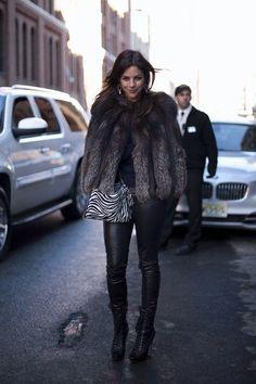 Julia Restoin-Roitfeld in fur, chandelier earrings, zebra purse, leather leggings, hiking boots.
