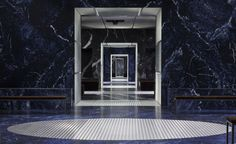 A/W 2015 / Prada: Each room was interconnected by floor-to-ceiling aluminium tunnels that appeared to stretch on endlessly like an optical illusion