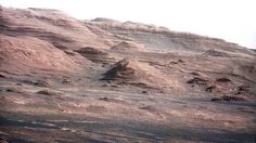 The layered geological history of Mars is laid bare in this colour image from NASA's Curiosity rover showing the base of Mount Sharp. The image was taken on August 23. Scientists enhanced the colour in one version to show the Martian scene under the lighting conditions we have on Earth, which helps in analyzing the terrain. The pointy mound in the centre of the image, looming above the rover-sized rock, is about 300 metres across and 100 metres high.