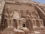 Abu Simbel Temple   The Temple of Re-Harakhte (The Sun Temple of Ramsis II): The main temple was dedicated to Ramsis II and to the four universal gods Ptah, Re-Harakhte, Amun-Re, and to Ramsis II himself. Of the seven temples he built, Abu Simbel is considered to be the most impressive.  Above the doorway in a niche stands the sun god, a falcon headed representation of Ramsis, holding a war-scepter which shows the head and neck of an animal which is read as use.