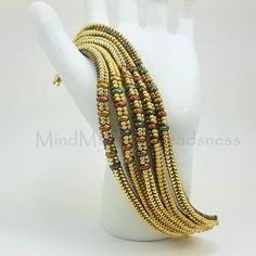 This PDF Beading Pattern - Sleeker Bracelet - Herringbone Stitch Tutorial is just one of the custom, handmade pieces you'll find in our patterns & how to shops. Beaded Bracelet Patterns, Beading Patterns, Beaded Jewelry, Beaded Necklace, Loom Patterns, Embroidery Patterns, Mosaic Patterns, Beaded Bead, Knitting Patterns