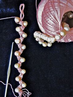 These are pink pearls paired with an antique pink shade of cordonnet crochet thread. Satin Pillows Necklace in progress.