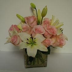 Lilies and Roses in a square vase www.nickisbloomingblossoms.com