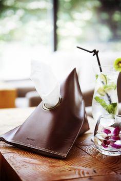KRAKEN - leather tissue holder.  Nice touch for the home