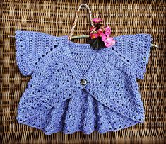 Flutter Sleeve Shrug by Mon Petit Violon... a crochet child's pattern available on Ravelry. Sweet little summer sweater. Lovely cotton yarn. Stitch definition is great. Easy on the hands…and sometimes I find cotton tiring to work with. Pretty easy pattern, just a few times where I...