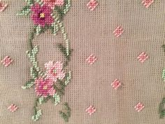A pretty preworked needlepoint canvas - Pink Posies with green accents Measures approximately 22 inches by 18 inches There is some faint staining, but otherwise the canvas is in excellent condition . No holes