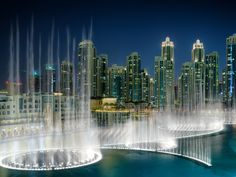 "From Incredible Fountains Around the World:  DUBAI FOUNTAIN: UAE Dubai is a major subscriber to the ""go big or go home"" school of thought, and the Dubai Fountain, located in front of the Dubai Mall, is no exception: The structure is 900 feet long with jets as tall as 45-story buildings, and daily water shows are set to popular music—everything from Whitney Houston to Edith Piaf."