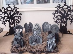 dollar store mini graveyard--could combine with the xmas houses, turned haunted houses...