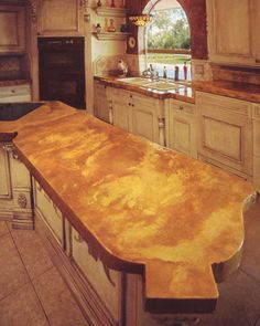 Metallic Countertop Paint : The countertops pictured here were concrete cast and poured. As such ...
