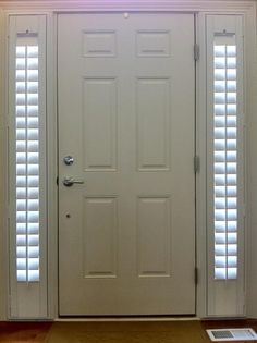 Entry Door with Two Side Lights | Shutters stay nice and tight to the door frame when opening and ...