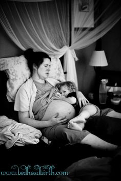 oh goodness how cute- mama in labour, while her toddler nurses, encouraging contractions