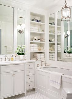 Suzie: Ashley Whittaker Design - Chic white bathroom with marble basketweave tiles floor, ...