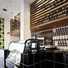 """« Older story Avanti restaurant by Studio OPA 17 August 2012 1 comment More: Interiors Restaurants and bars Rows of interchangeable tiles spell out what's on the menu at this fast-food pasta outlet in Tel Aviv, designed by Studio OPA as a """"tribute to Scrabble""""."""