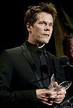 Bacon receiving a Merit Award in April 2010