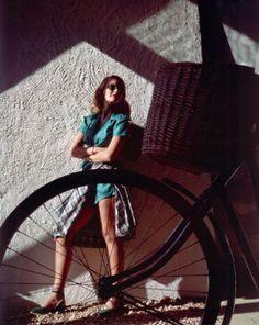1944 --- Model behind bicycle wearing blouse and shorts set of green silk shantung, gingham shirt around waist Shirt Around Waist, New Bicycle, Bike, Gingham Shirt, Silk Shorts, Famous Photographers, 1940s Fashion, Green Silk, Colorful Fashion