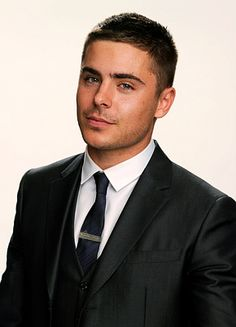 Zac Efron in my favorite type of men's clothing...the three piece suit. Excuse me while I drool.