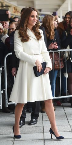 In a Max Mara Studio coat. See all of Kate Middleton's maternity looks.
