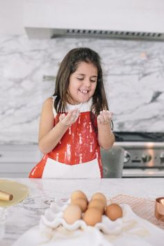 Getting children involved in the kitchen and making meals is fun and easy with these adorable adjustable apron sets for child and adult - your little girl can match mom or dad with her own apron!