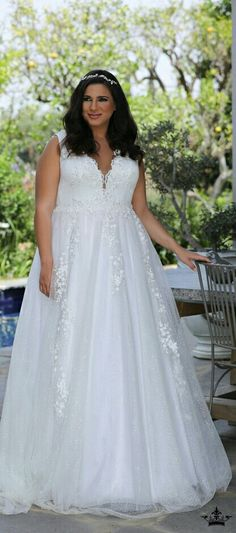 Plus size sparkling ball gown with V- neck and 3d flowers
