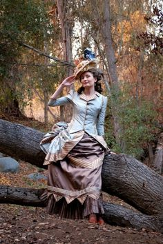 1880s Bustle Dress and Hat.  See how much better she looks than in modern clothes?