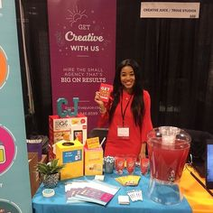 Our #girlboss showing off what we have to offer at the #smallbizexpo. Stop by booth 102 to say hello chat with us about your creative needs or for a chance to win some juicy prizes! Not to mention we've got some passion punch to sip on as well  #smallbiz #smallbusiness #business #entrepreneur #boss #agency #marketing #design#grahicdesign #graphics #atlanta #getcreative #thejuicers