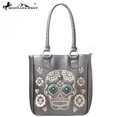 Montana West Sugar #Skull purse   Available in Black or Pewter which is shown • Sugar Skull with conchos on the front  with embroidery flower and silver studs  Double flat straps 14.5 x 5 x 11 (10.5 strap) check them out online 49.95 at http://www.endlessxpressions.com/store/#charmers