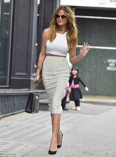Sophisticated: Chrissy oozed elegance on an earlier outing in the Big Apple