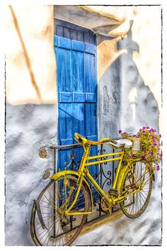 Love the colors and bicycle hanging off the balcony in Naxos, Greece.  ASPEN CREEK TRAVEL - karen@aspencreektravel.com