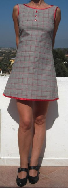 A- line dress, made from Prince of Galles stretch cotton fabric. Satin red bindings. The plaids colors are black, white and red. This dress fits the size S/M. (chest 86 cm, breast 94 cm; waist 70 cm; hips 96 cm ). One of a kind.