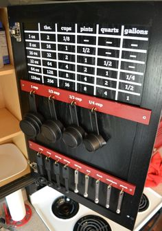 DIY Measurement Conversion Chart You can organize your measuring cups inside your cabinet doors and add a handy conversion chart so you never have to stop and look up conversions. - Innovative Kitchen Organization and Storage DIY Projects Diy Organizer, Utensil Organizer, Do It Yourself Furniture, Do It Yourself Home, Kitchen Organization, Kitchen Storage, Organization Ideas, Storage Ideas, Diy Kitchen