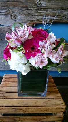 This arrangement features pink gerbera daisies, white hydrangea, pink roses, and white alstroemeria. www.bloominggalsbouquets.com http://on.fb.me/1BT3HNz