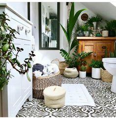 plant filled bathroom
