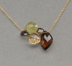 necklace pendant brown multi gemstone cluster on silver chain. $75.00, via Etsy.