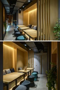This modern coffee shop seating area is surrounded by wood with banquette seating, wood tables, upholstered stools and hidden lighting. Coffee Table With Stools, Round Coffee Table, Modern Coffee Tables, Cafe Seating, Banquette Seating, Coffee Shop, Coffee Club, Hidden Lighting, Design Garage