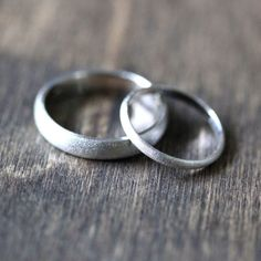White Gold Wedding Set, Brushed Men's and Women's His and Hers 4mm Low Dome Recycled 14k Palladium White Gold Wedding Ring Couple's Set by TheSlyFox on Etsy https://www.etsy.com/listing/196473091/white-gold-wedding-set-brushed-mens-and