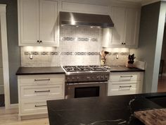Nice mix of porcelain and stainless mosaics. Materials sourced by Cook & Kozlak. Timeless Design, Mosaics, Backsplash, Kitchen Cabinets, Porcelain, Nice, Cooking, Simple, Home Decor