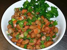 Ful Medames Salad - The beans, tomato and fresh herbs in this salad will usher you into the flavors of spring.