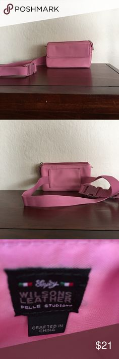 """Wilson Leather Wallet Fannypack Wilsons Leather Pele Studio Wallet Fannypack. Pink with 3 zipper pockets and 1 front flap pocket that has a snap closure.  Fits up to 39"""" waist.   Adjustable strap.  Approximately 6.5"""" wide x 3.5 high. Wilsons Leather Bags Wallets"""