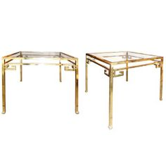 A Pair of Bronze Side Tables