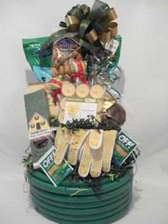 make basket for new home owners- with water hose as the base- also add snacks, water bottles, dog bones, card + appliance manuals.