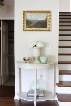 Entry way with demilune table and artwork