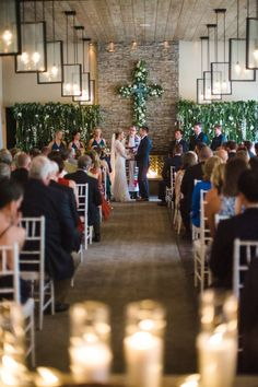 Romantic Chapel Ceremony with Greenery Décor | Photo: Cameron & Kelly Studio.